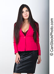 A young pretty slim asian woman in a black leather skirt and a red jacket