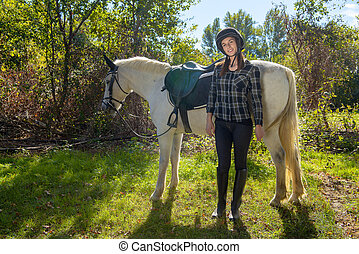 young rider woman with white horse