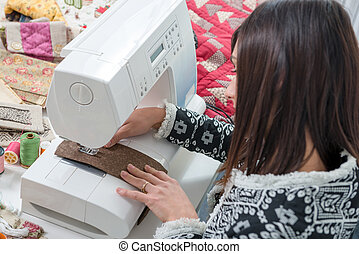 young seamstress with her sewing machine