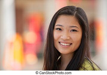Asian girl - A young smiling Asian girl