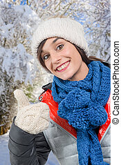 young smiling brunette woman with a winter cap