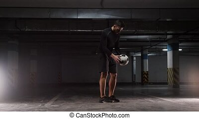 A young soccer man showing the basic tricks with the ball....