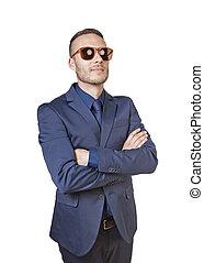 thinking elegant businessman with sunglasses