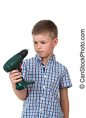 A young thoughtful builder boy in the plaid shirt holds a screwdriver, isolated on white background