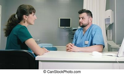 A young woman consults a doctor about gastroscopy