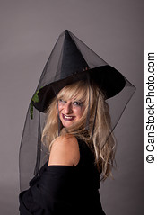 a young woman dressed as a witch