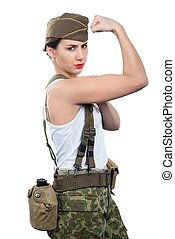 young woman dressed in wwii military uniform show her biceps