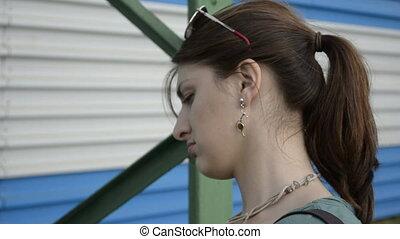 A young woman expresses contempt