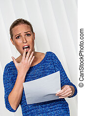 woman gets bad news - a young woman gets bad news in a...
