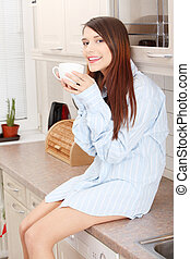 A young woman having morning coffee