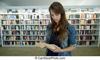 A young woman in a public library. It's her leisure time and...