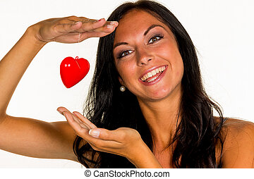 young woman in love - a young woman in love holds a heart in...