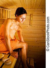 sauna - a young woman in the sauna