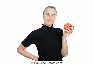 young woman is holding an apple in her hand and smiling