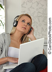 a young woman listening music