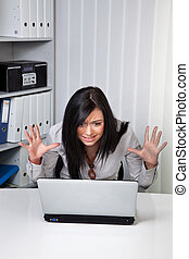 A young woman on a desperate Computerprob