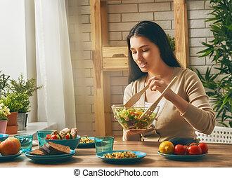 woman prepares the family dinner