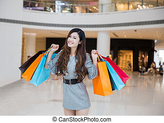 a young woman shopping in mall