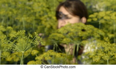 A young woman sits at a dill