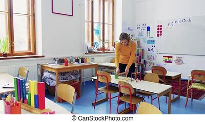 A young woman teacher in the classroom at school. - A young...