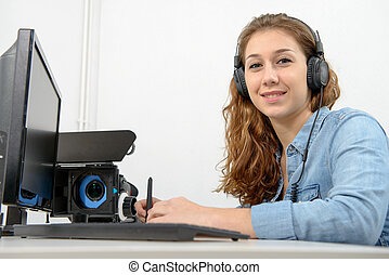 young woman using computer for video editing - a young woman...