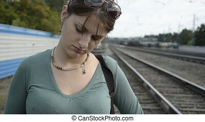 A young woman waiting for train