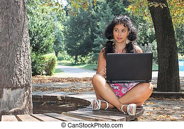 A young woman with a laptop