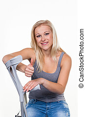 woman with crutches - a young woman with crutches. symbolic ...