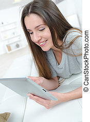 a young woman with tablet