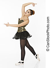 a young wonderful ballerina is dancing gracefully