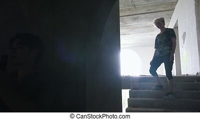 A zombie walking on the stairs and a man survivor aiming...