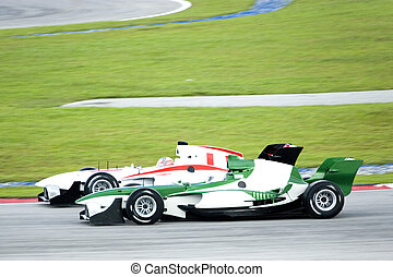 A1 Grand Prix race cars in action.