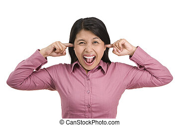 A young woman is disturbed by loud noise around her and close her ears using both index fingers. Shot against white background.