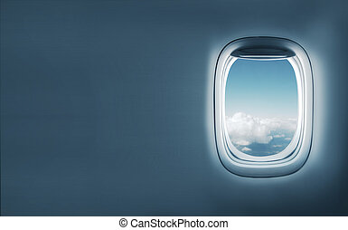 Aairplane window with clouds view