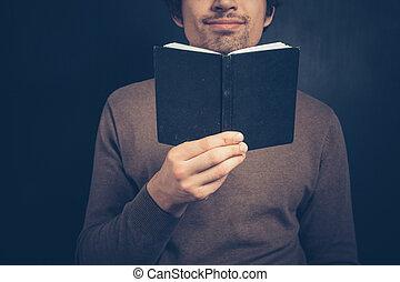 aantekenboekje, jonge man
