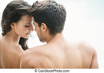 aantrekkelijk, paar, zittende , poolside, het glimlachen