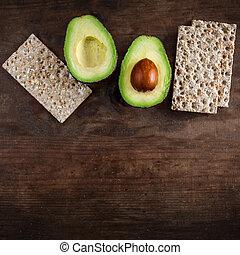aanzicht, fruit., wholegrain, halves, bruine , houten, brood, knapperig, copyspace., schijfen, achtergrond., bovenzijde, twee, avocado