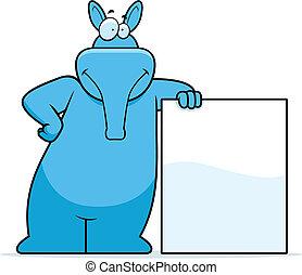 A happy cartoon aardvark leaning on a sign.