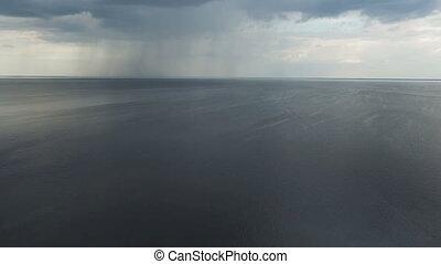 Aarial View of Rain Above Pond.