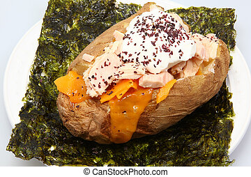 Abacore Tuna stuffed Baked Potato on Seaweed with Dulse Flakes, Cheese and Sour Cream