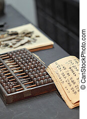 abacus and book on the table in a chinese old shop