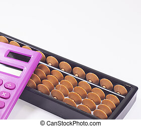 Abacus and pink calculator on white background