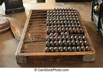 Abacus - Old wooden retro abacus on the table