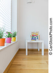 Abacus on table in child room