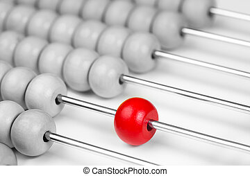 Abacus red bead closeup. Leadership concept.