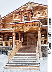 Wooden Snowy owl tavern of abalak tourist complex