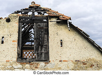 Abandoned and burnt small building