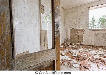 Abandoned and ruined room with broken door
