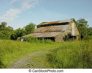 Old farm structure that has outlived it's usefullness due to urban expansion.