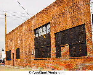 Abandoned Boarded Up Brick Commercial Building